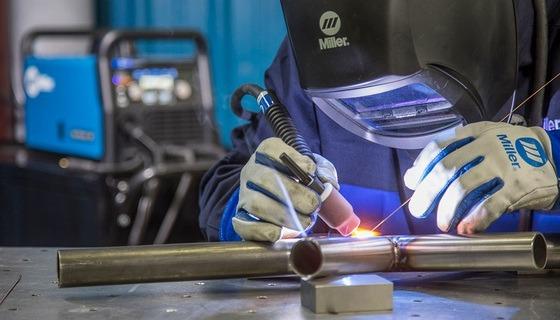 A welder is performing TIG welding
