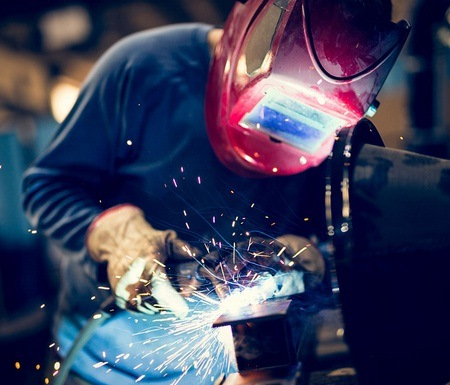 A welder is welding using MIG method