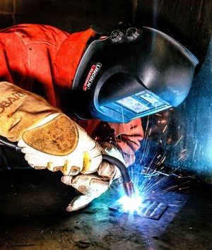 Welder is protected by gloves