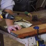 How to remove a stuck drill bit from wood?